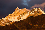 Seen from Incahuain / Jahuacocha campground, golden sunset light spotlights Nevado Jirishanca (Icy Beak of the Hummingbird, 6126 m or 20,098 feet). Day 8 of 9 days trekking around the Cordillera Huayhuash in the Andes Mountains, one day's walk from LLamac, Peru, South America.