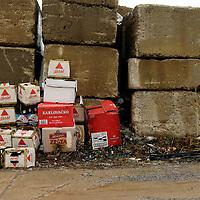 Empty beer cartons along roadway