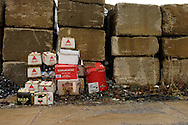 Empty beer cartons along roadway