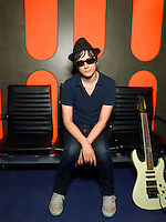 Young man in sunglasses with guitar portrait