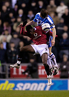 Photo: Jed Wee.<br /> Wigan Athletic v Manchester United. The Barclays Premiership. 06/03/2006.<br /> <br /> Wigan's Arjan de Zeeuw (R) keeps Manchester United's Louis Saha at bay.