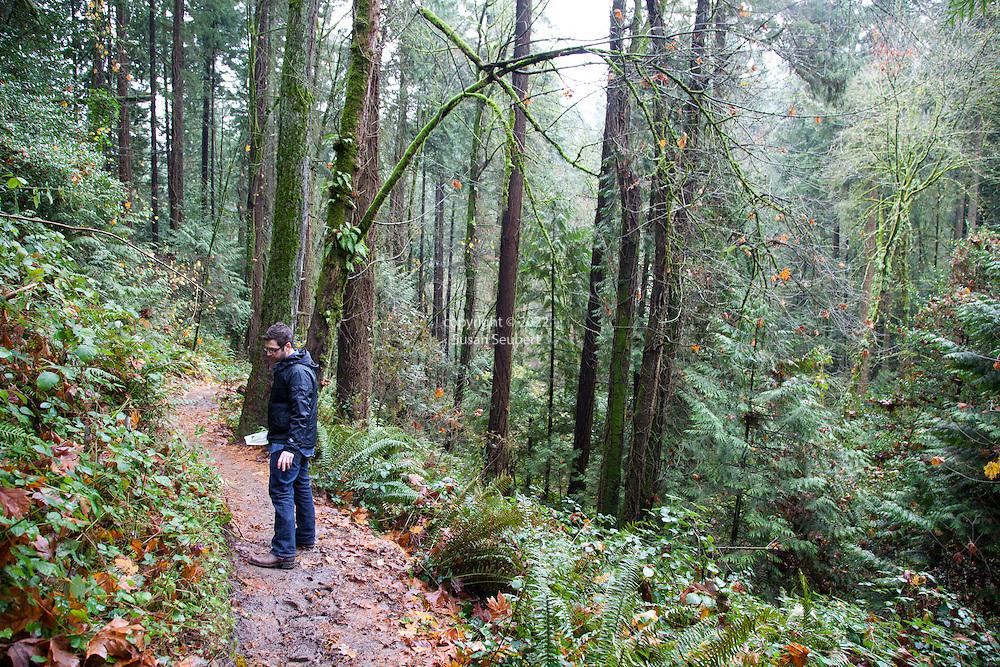 Castagna Chef, Matthew Lightner, foraging for wild greens from a forest in Portland, Oregon