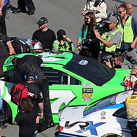 Danica Patrick, driver of the #7 GoDaddy Chevrolet prepares to climb into her race car during the 60th Annual NASCAR Daytona 500 auto race at Daytona International Speedway on Sunday, February 18, 2018 in Daytona Beach, Florida.  (Alex Menendez via AP)