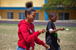 Riana Isaac.  Impacting Your World Christian Ministries helicopter egg drop at Charlotte Amalie High School.  St. Thomas, USVI.  4 April 2015.  © Aisha-Zakiya Boyd