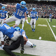 Xavier  Moss, Army, is tackled by Kalon Baker, Air Force,   during the Army Black Knights Vs Air Force Falcons, College Football match at Michie Stadium, West Point. New York. Air Force won the game 23-6. West Point, New York, USA. 1st November 2014. Photo Tim Clayton