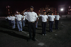 "Active army reservist Jose Navarro trains with civilians  for the Venezuelan Army reserve in an empty parking lot surrounded by apartment buildings in El Paraiso, a poor neighborhood in western Caracas, Venezuela.  The group is trained by an army general 6 times a week in a the parking lot, which has been turned into a Chavista complex that also houses several of the President's missions which help the poor.  Rhetoric has been more heated between the US and Venezuela ever since Chavez won a decisive referendum on his rule last August.  Many of the community members in training say they need to train to protect their country from any enemies it has. adding that a ""yankee invasion"" is a possibility."