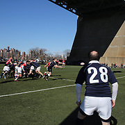 Action during the Binghamton Devils (red) V White Horse rugby match during the Four Leaf 15's Club Rugby Tournament at Randall's Island New York. The tournament included 70 teams in 6 divisions, organized by the New York City Village Lions RFC. Randall's Island, New York, USA. 23rd March. Photo Tim Clayton