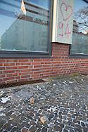Berlin, Germany - 19.01.2016 <br /> <br /> About 4 o'clock in the morning noticed a house technician damages on the Social Democratic Party of Germany office of Ralf Wieland in Berlin-Gesundbrunnen. 5 windows were damaged by stone throws. In addition, slogans were left with Rigaer94 reference. As well as the slogan &quot;#tomduarsch&quot; who apparently directed against the Berlin SPD politician Tom Schreiber. It is the fourth attack on the office within six months.<br /> <br /> Gegen 4 Uhr morgens bemerkte ein Haustechniker die Schaeden am SPD-Buergerbuero von Ralf Wieland in Berlin-Gesundbrunnen. 5 Scheiben wurden durch Steinwuerfe beschaedigt. Au&szlig;erdem wurden die Schriftzuege mit Rigaer94-Bezug hinterlassen. Sowie der Schriftzug &quot;#tomduarsch&rdquo;, der sich offenbar gegen den Berliner SPD-Politiker Tom Schreiber richtet. Es ist die vierte Attacke auf das Buero innerhalb von sechs Monaten.<br /> <br /> Photo: Bjoern Kietzmann