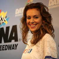 Actress Alyssa Milano is seen in the press area, prior to the NASCAR Coke Zero 400 Sprint series auto race at the Daytona International Speedway on Saturday, July 6, 2013 in Daytona Beach, Florida.  (AP Photo/Alex Menendez)