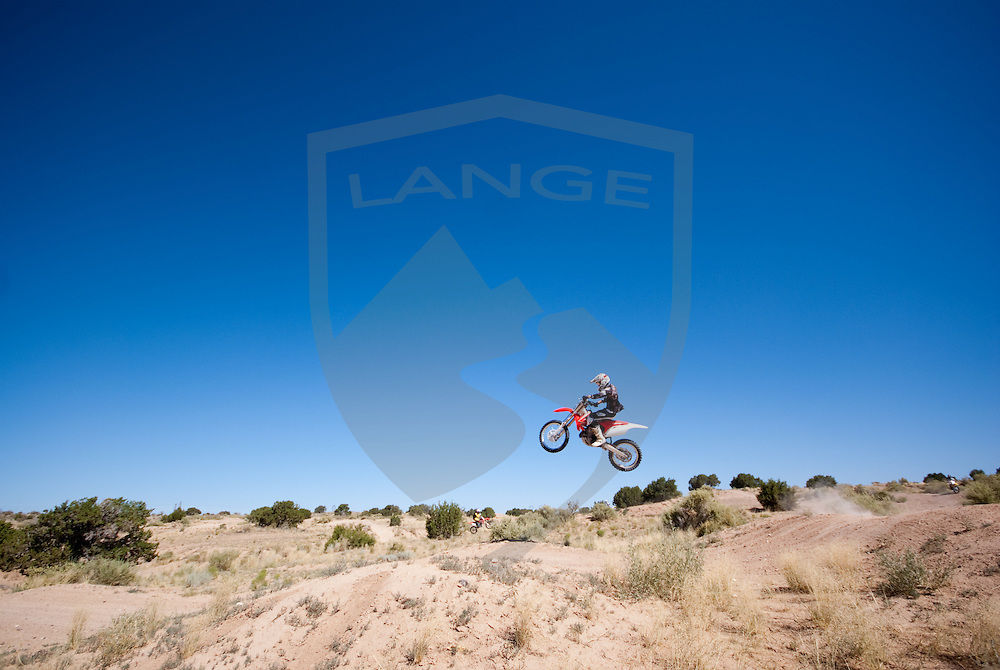 motorcycle rider chris boice jumping. taken at west mesa moto tracks on the western fringe of albuquerque, new mexico.
