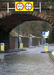 © Licensed to London News Pictures. 27/01/2013..Cleveland, England, UK..Following the recent snowfall a fast thaw through the night brought heavy flooding to some parts of Cleveland and North Yorkshire with many roads closed...A wall is under pressure from the melted snow at North Skelton in Cleveland...Photo credit : Ian Forsyth/LNP
