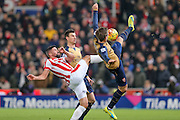Stoke City forward Jonathan Walters catches Arsenal defender Nacho Monreal  during the Barclays Premier League match between Stoke City and Arsenal at the Britannia Stadium, Stoke-on-Trent, England on 17 January 2016. Photo by Simon Davies.