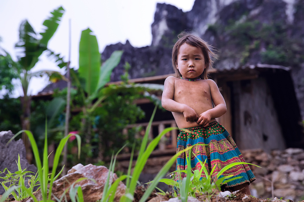 A girl in her mountain home on the Dong Van plateu, Vietnam.