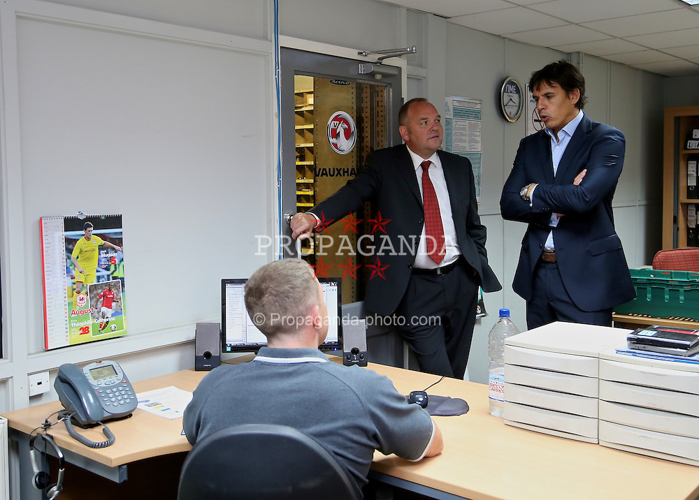 CARDIFF, WALES - Wednesday, August 27, 2014: Wales' manager Chris Coleman meets staff at the Evans Halshaw Vauxhall dealership as he announces his squad for the opening UEFA Euro 2016 qualifying match against Andorra. (Pic by David Rawcliffe/Propaganda)