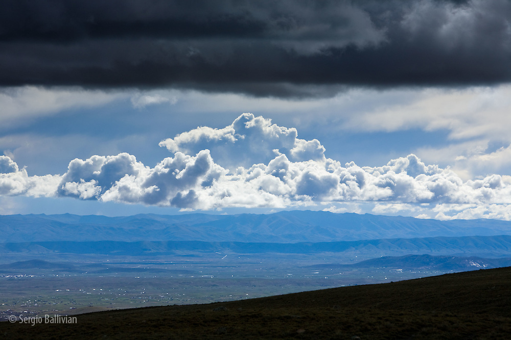 Clouds bring rain during the wet season on the Bolivian Altiplano.  The rainy season in Bolivia is from November to March and brings the vast majority of rain to the highland and lowland regions.