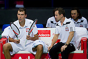 (L) Jerzy Janowicz and (R) Radoslaw Szymanik - captain national team during the BNP Paribas Davis Cup 2014 between Poland and Croatia at Torwar Hall in Warsaw on April 4, 2014.<br /> <br /> Poland, Warsaw, April 4, 2014<br /> <br /> Picture also available in RAW (NEF) or TIFF format on special request.<br /> <br /> For editorial use only. Any commercial or promotional use requires permission.<br /> <br /> Mandatory credit:<br /> Photo by &copy; Adam Nurkiewicz / Mediasport