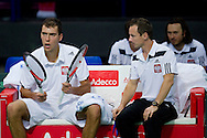 (L) Jerzy Janowicz and (R) Radoslaw Szymanik - captain national team during the BNP Paribas Davis Cup 2014 between Poland and Croatia at Torwar Hall in Warsaw on April 4, 2014.<br /> <br /> Poland, Warsaw, April 4, 2014<br /> <br /> Picture also available in RAW (NEF) or TIFF format on special request.<br /> <br /> For editorial use only. Any commercial or promotional use requires permission.<br /> <br /> Mandatory credit:<br /> Photo by © Adam Nurkiewicz / Mediasport