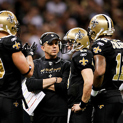 January 7, 2012; New Orleans, LA, USA; New Orleans Saints head coach Sean Payton talks with quarterback Drew Brees (9), wide receiver Marques Colston (12) and tight end Jimmy Graham (80) during the 2011 NFC wild card playoff game against the Detroit Lions at the Mercedes-Benz Superdome. Mandatory Credit: Derick E. Hingle-US PRESSWIRE