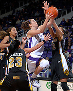 Kansas State forward Ashley Sweat (4) drives through three Missouri defenders Alyssa Hollins (12), Blair Hardiek (23) and Eetisha Riddle for the score, during the second half at Bramlage Coliseum in Manhattan, Kansas, January 13, 2007.  K-State beat the Missouri Tigers 81-66.