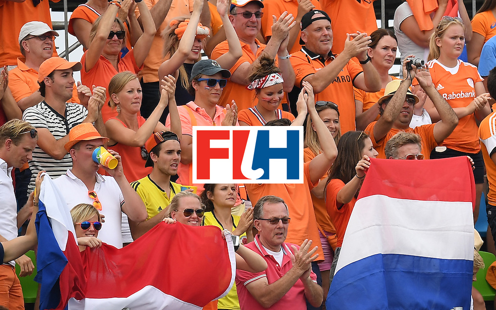 Netherland's fans cheer after the men's field hockey Netherlands vs Canada match of the Rio 2016 Olympics Games at the Olympic Hockey Centre in Rio de Janeiro on August, 9 2016. / AFP / MANAN VATSYAYANA        (Photo credit should read MANAN VATSYAYANA/AFP/Getty Images)