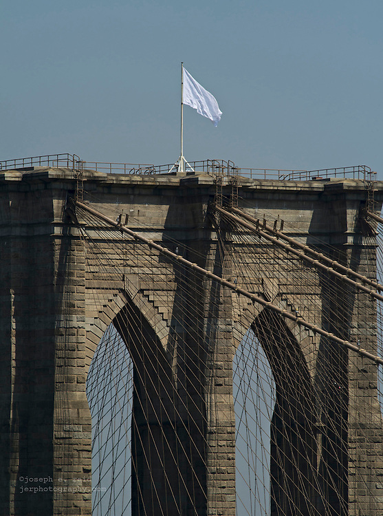 White flag flies from the Brooklyn Bridge