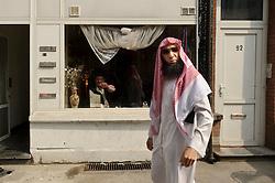 "Fouad Belkacem, a.k.a. Abu Imran, an Islamic extremist who is spearheading the movement ""Sharia4Belgium"", walks through the Borgerhout neighborhood of Antwerp, Belgium on Tuesday, April 3, 2012. (Photo © Jock Fistick)"