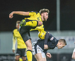 Livingston Morgan Neill tackles Falkirk's John Baird. Falkirk 2 v 0 Livingston, Scottish Championship game played 29/12/2015 at The Falkirk Stadium.