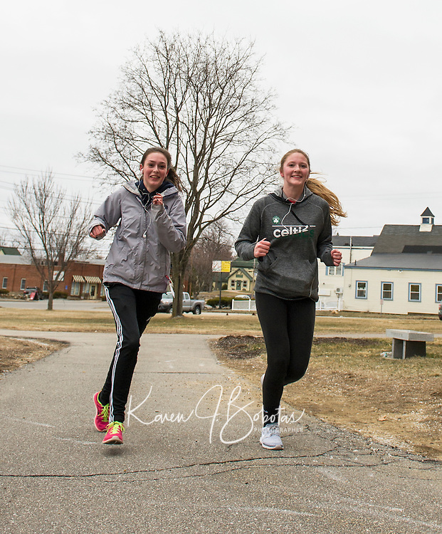 "On the path to Spring after the ""Winter that wasn't"" for LHS girls Lacrosse players starting training with a run through Laconia Thursday afternoon.  (Karen Bobotas/for the Laconia Daily Sun)"