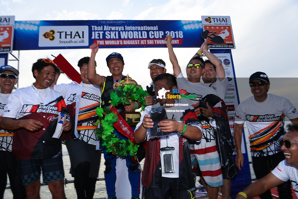 PATTAYA, THAILAND - DECEMBER 09: Hajime Isahai (J87) of Japan and Marine Mechanic celebrate on the podium with the King's Cup during the Royal Trophy presentation for the Pro Runabout GP at the Thai Airways International Jet Ski World Cup 2018, Jomtien Beach, Pattaya, Thailand on December 09, 2018. <br /> .<br /> .<br /> .<br /> (Photo by: Naratip Golf Srisupab/SEALs Sports Images)<br /> .<br /> Any image use must include a mandatory credit line adjacent to the content which should read: Naratip Golf Srisupab/SEALs Sports Images