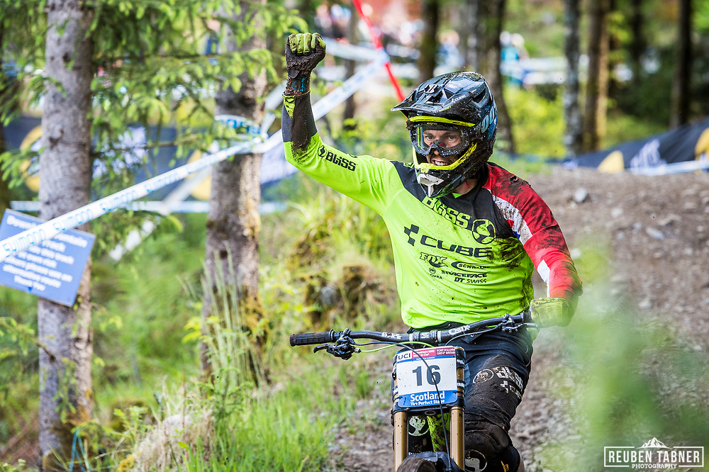 Greg Williamson salutes his home crowd after crashing hard during his race run at the UCI Mountain Bike World Cup in Fort William.