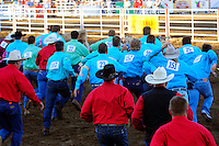 Contestants rush toward their targets at the Wrangler Calf Dressing competition at the 102nd California Rodeo Salinas, which opened July 19 for a four-day run.
