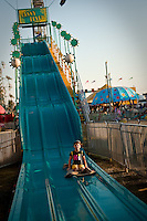 JEROME A. POLLOS/Press..Rheana sliding solo down the fanny flyer at the fair on Sunday, August 30, 2009. She slide down earlier with her sister and had fun.