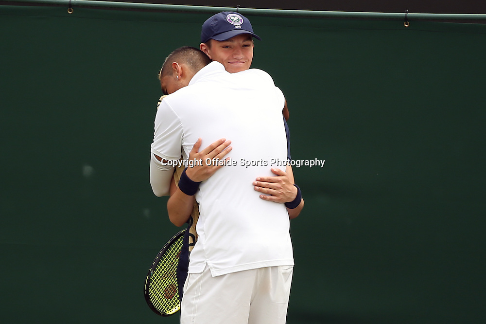 6 July 2015 - Wimbledon Tennis (Day 7) -  Nick Kyrgios (AUS) hugs a ball boy during his fourth round match against Richard Gasket (FRA) - Photo: Marc Atkins / Offside.