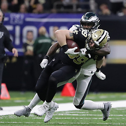 Jan 13, 2019; New Orleans, LA, USA; New Orleans Saints tight end Josh Hill (89) is tackled by Philadelphia Eagles strong safety Malcolm Jenkins (27) during the third quarter of a NFC Divisional playoff football game at Mercedes-Benz Superdome. Mandatory Credit: Derick E. Hingle-USA TODAY Sports