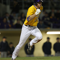 2009 February 20: LSU's DJ LeMahieu (17) run to first base during a NCAA baseball match up between the #1 ranked LSU Tiger and the unranked Villanova Wilcats at the newly constructed Alex Box Stadium in Baton Rouge, Louisiana..