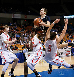 Magnolia's Derrick Blain (5) flys his way through two Greater Beckley Christian defenders during a semi final round game at the Charleston Civic Center.