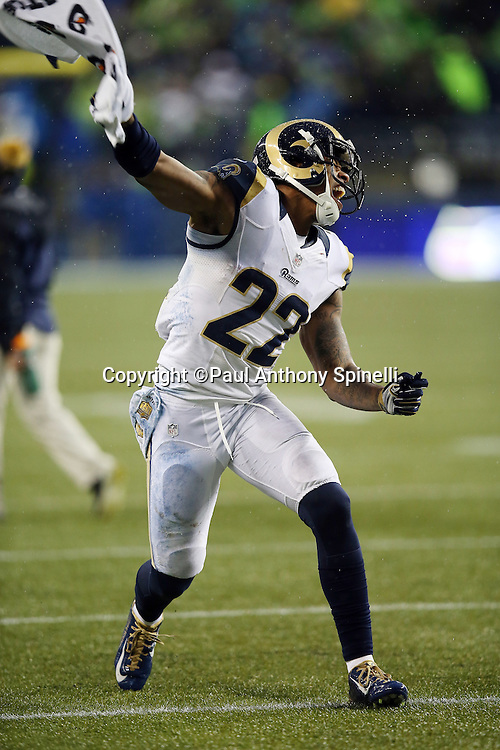 St. Louis Rams cornerback Trumaine Johnson (22) waves a towel wildly and yells out in celebration after a Rams fumble recovery that stopped a potential scoring drive and a Seattle Seahawks comeback attempt late in the fourth quarter during the 2015 NFL week 16 regular season football game against the Seattle Seahawks on Sunday, Dec. 27, 2015 in Seattle. The Rams won the game 23-17. (©Paul Anthony Spinelli)
