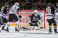KELOWNA, CANADA - FEBRUARY 16: Michael Herringer #30 of Kelowna Rockets makes a save against the Red Deer Rebels on February 16, 2016 at Prospera Place in Kelowna, British Columbia, Canada.  (Photo by Marissa Baecker/Shoot the Breeze)  *** Local Caption *** Michael Herringer;