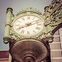 Chicago great clock vintage picture. The famous Chicago clock is on the Macy's building and is one of the Marshall Fields Great Clocks that adorns the corners of the Marshall Field and Company building. Photo has an old  vintage retro tone. Image Copyright © Paul Velgos All Rights Reserved.