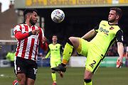 Exeter City defender Pierce Sweeney (2) and Lincoln City forward Matt Green (10) battles for possession  during the EFL Sky Bet League 2 match between Lincoln City and Exeter City at Sincil Bank, Lincoln, United Kingdom on 30 March 2018. Picture by Mick Atkins.