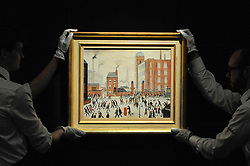 "© Licensed to London News Pictures. 17/11/2017. London, UK.  London, UK.  17 November 2017. Technicians display ""The Rush Hour"", 1964, by L.S. Lowry (Est. GBP 0.8-1.2m).  Preview upcoming auctions of Modern & Post War British Art and Scottish Art taking place at Sotheby's, New Bond Street, on 21 and 22 November. Photo credit: Stephen Chung/LNP"