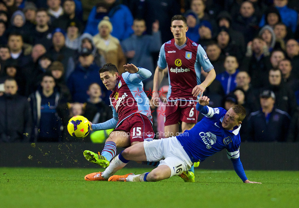 LIVERPOOL, ENGLAND - Saturday, February 1, 2014: Everton's James McCarthy in action against Aston Villa's Ashley Westwood during the Premiership match at Goodison Park. (Pic by David Rawcliffe/Propaganda)
