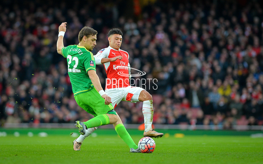 Sunderland Defender Sebastian Coates and Arsenal Midfielder Alex Oxlade-Chamberlain during the The FA Cup match between Arsenal and Sunderland at the Emirates Stadium, London, England on 9 January 2016. Photo by Adam Rivers.