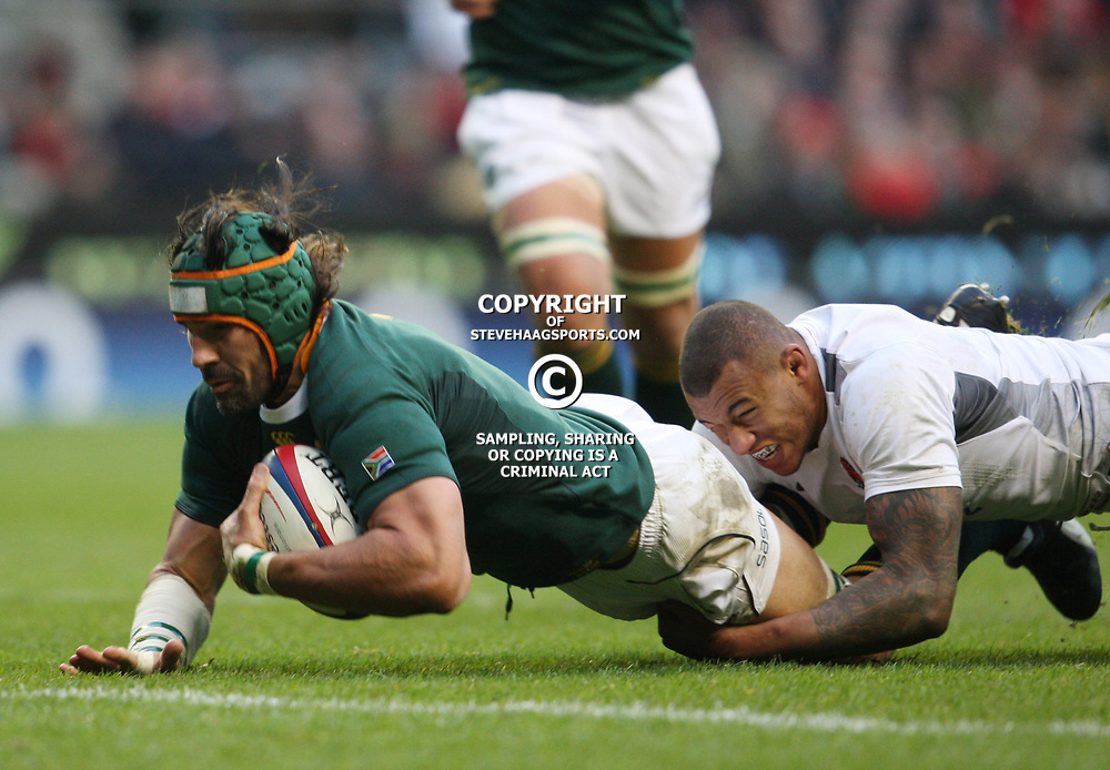 LONDON, ENGLAND - NOVEMBER 27, Victor Matfield (capt) is well tackled by Courtney Lawes during the End of Year tour match between England and South Africa at Twickenham Stadium on November 27, 2010 in London, England<br /> Photo by Steve Haag / Gallo Images