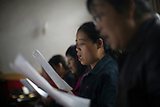 Chinese Christians  sing in a choir in Pucheng, Shanxi.