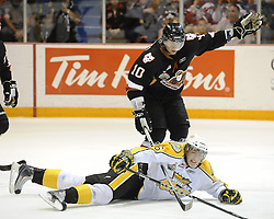 Alexander Urbom of the Brandon Wheat Kings blocks a shot in front of Misha Fisenko of the Calgary Hitmen in the semi-final game of the 2010 MasterCard Memorial Cup in Brandon, MB on Friday May 21. Photo by Aaron Bell/CHL Images