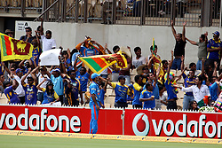 © Licensed to London News Pictures. 14/02/2012. Adelaide Oval, Australia. Sri Lankan fans celebrate as Dilshan hits a 6 into the stands during the One Day International cricket match between India Vs Sri Lanka. Photo credit : Asanka Brendon Ratnayake/LNP
