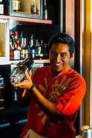 Bartender, Sunset Bar, Four Seasons Resort Bora Bora, Motu Tehotu, Bora Bora, Society Islands, French Polynesia.