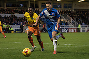 Hartlepool United striker Scott Fenwick (goal scorer) in action shadowed by Anthony Stewart (Defender) of Wycombe Wanderers during the Sky Bet League 2 match between Hartlepool United and Wycombe Wanderers at Victoria Park, Hartlepool, England on 16 January 2016. Photo by George Ledger.
