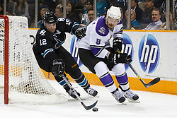 April 4, 2011; San Jose, CA, USA;  San Jose Sharks center Patrick Marleau (12) reaches for a loose puck in front of Los Angeles Kings defenseman Drew Doughty (8) during the first period at HP Pavilion. San Jose defeated Los Angeles 6-1. Mandatory Credit: Jason O. Watson / US PRESSWIRE